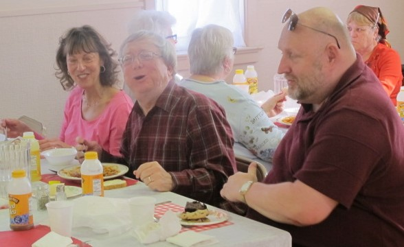 Betsy, Fr. Tim and Wayne